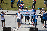 MOSCOW, RUSSIA - June 16, 2018:  A Germany and Argentina fan interrupts a Iceland fans pre-game rally at Zaryadiye park before their game against Argentina at the 2018 FIFA World Cup.