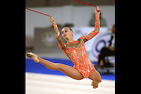 September 21, 2007; Patras, Greece;  Irina Kovalchuk of Ukraine split leaps with rope during the All-Around final at 2007 World Championships Patras. Irina was a giant hero for Ukraine at Patras... On this day she woke with a fever, said to be 39 Celcius and then single handedly qualified Ukraine to receive the 2nd of 2 positions for the individual All-Around competition at Beijing 2008 Olympics.  Photo by Tom Theobald. .