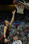 San Diego State guard Malachi Flynn (22) lays the ball against  Nevada during the first half of a basketball game played at Lawlor Events Center in Reno, Nev., Saturday, Feb. 29, 2020. (AP P /Tom R. Smedes)