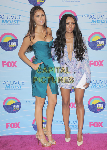 Nina Dobrev and Kat Graham.Teen Choice Awards 2012 - Press Room held at Gibson Amphitheatre, Universal City, California, USA..July 22nd, 2012.full length white clutch bag blue print dress blazer hand on hip blue teal strapless origami gold sandals shoes .CAP/RKE/DVS.©DVS/RockinExposures/Capital Pictures.