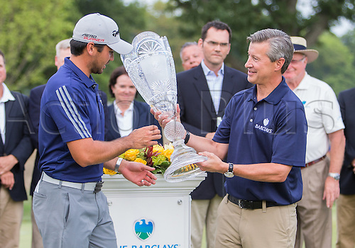 August 30, 2015: Jason Day is presented with a trophy after shooting 19 under par to win The Barclays  at Plainfield Country Club in Edison, NJ.