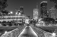 Houston-Bridge-over-Bayou BW - Took this black and white on the bridge of the Sabine to Bagby pedestrian walkway as it crosses over the Buffalo bayou in downtown Houston with the high rise skyline in view.