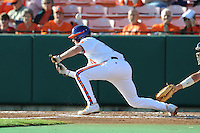 Second Baseman Steve Wilkerson #17 of the Clemson Tigers attempts to bunt during  a game against the North Carolina Tar Heels at Doug Kingsmore Stadium on March 9, 2012 in Clemson, South Carolina. The Tar Heels defeated the Tigers 4-3. Tony Farlow/Four Seam Images.