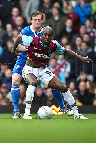 09.04.2012. East London, England. England international Carlton COLE of West Ham United tussles with Scottish international defender Steven CALDWELL of Birmingham City during the npower Championship match between West Ham United and Birmingham City at Upton Park.  Final score: West Ham United 3-3 Birmingham City.
