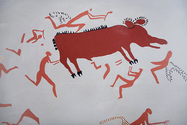 Close up of a recontructed fresco of an original found at Catalhoyuk. The men are hunting an animal. Reconstructed houses, Painted by Mutlu Gundiler. 7500 BC to 5700 BC, Catalyhoyuk Archaeological Site, Çumra, Konya, Turkey