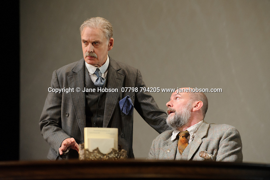 London, UK. 09.11.2015. WASTE, by Harley Granville Barker, directed by Roger Michell, opens at the National Theatre. Picture shows: William Chubb (George Farrant), Paul Hickey (Justin O'Connell). Photograph © Jane Hobson.