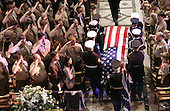 Washington, D.C. - January 2, 2007 -- Boy Scouts salute as the casket of former President Gerald R. Ford, who was an Eagle Scout, is carried into the Washington National Cathedral in Washington, Tuesday, Jan. 2, 2007 for a State Funeral service. <br /> Credit: Pablo Martinez Monsivais-Pool via CNP