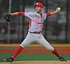 Liam Pulsipher #14, Center Moriches starting pitcher, delivers to the plate in the bottom of the first inning of a Suffolk County varsity baseball game against host Babylon High School on Monday, April 17, 2017. He held Babylon to one run over 6 2/3 innings of work and was the winning pitcher of record in the Red Devils' 3-1 victory.