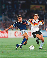 Juergen Klinsmann and Nestor Lorenzo challenge for the ball in the  World Cup final of Italia 90.