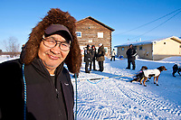Volunteer Kaltag checker Tucker Semaken outside the Kaltag checkpoint during the 2010 Iditarod