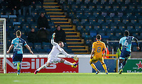 Mark Randall of Newport County scores his goal past Goalkeeper Scott Brown of Wycombe Wanderers to make it 0 1 during the Sky Bet League 2 match between Wycombe Wanderers and Newport County at Adams Park, High Wycombe, England on 2 January 2017. Photo by Andy Rowland.
