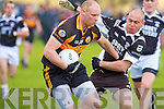 Austin Stacks Gearoid McCann and Ardfert's Conor Flaherty.