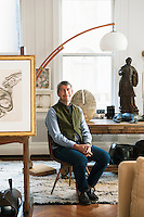 Portrait of Keith Johnson, founder and chief buyer for fashion and interiors retailer Anthropolgie, in the living room of his New York apartment