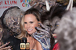 Entertainment Tonight host surrounded by Heidi Klum as Michael Jackson's Thriller Werewolf and zombies at Heidi Klum's 18th Annual Halloween Party presented by Party City and SVEDKA Vodka at Magic Hour Rooftop Bar & Lounge at Moxy Times Square, on October 31, 2017.