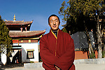 CHINA Yunnan, Yongningxiang, buddhist Lama Temple and monastery Zhamei, this region is home of the ethnic minority Mosuo who are buddhist, tibetan monk ZHA XI / CHINA Yunnan, Yongningxiang, buddhistischer Lama Tempel und Kloster Zhamei, diese Region ist Heimat der ethnischen Minderheit Mosuo, die Mosuo sind Buddhisten, tibetischer Moench ZHA XI, 19 Jahre alt