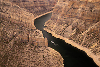 Bighorn Canyon National Recreation Area, Devil Canyon, Bighorn River, MT, WY, Montana, Wyoming, Scenic view of a boat cruising along the Bighorn River from Devil Canyon Overlook in Bighorn Canyon Nat'l Recreation Area in Montana.