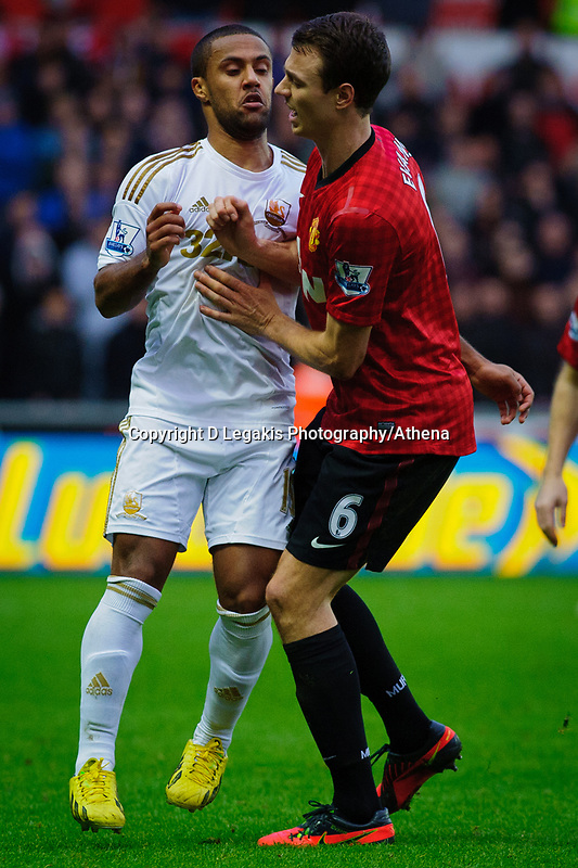 Sunday, 23 November 2012<br /> <br /> Pictured: Wayne Routlage of Swansea City and Jonny Evans of Manchester United <br /> <br /> Re: Barclays Premier League, Swansea City FC v Manchester United at the Liberty Stadium, south Wales.