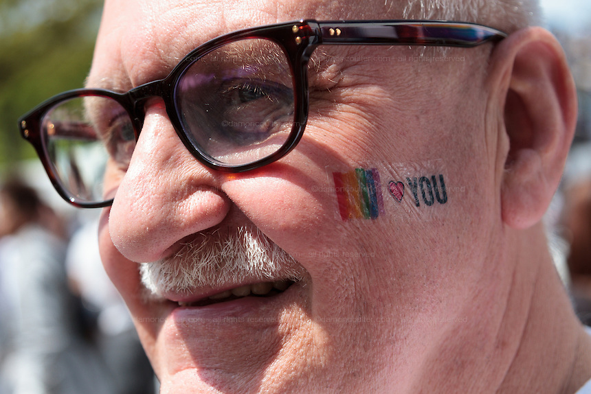An older European man with a rainbow Pride tattoo at The Rainbow Pride Event in Yoyogi Park, Shibuya, Tokyo, Japan. Sunday, April 26th 2015. This is the forth annual celebration of LGBT issues in Tokyo and forms part of a wider Rainbow Week. About 5% of the Japanese population identify as homosexual and this event hopes to foster a society where they can live equally and without prejudice.