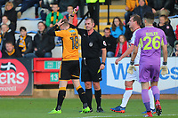 George Maris of Cambridge is shown a red card and sent off by referee Darren Handley during Cambridge United vs Sutton United , Emirates FA Cup Football at the Cambs Glass Stadium on 5th November 2017