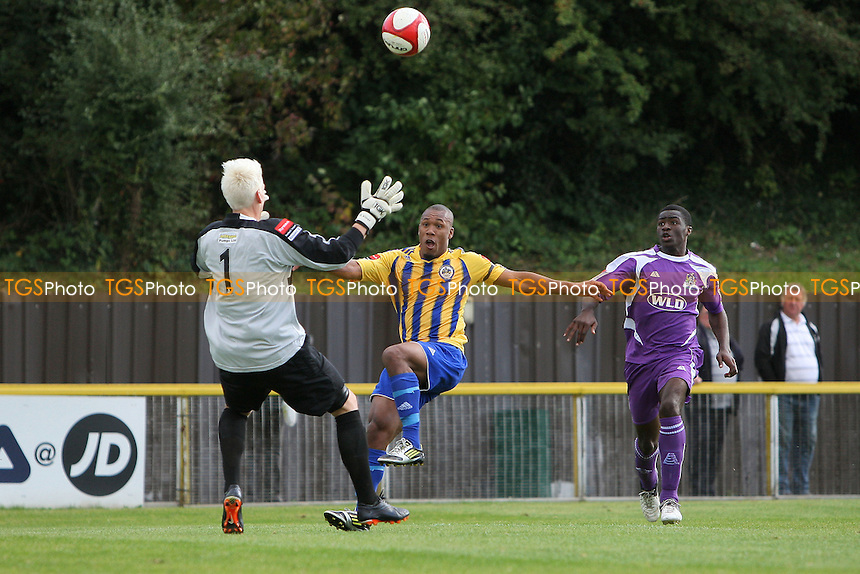 Ryan Imbert of Romford chips the ball over Will Viner but just wide - Romford vs Thurrock - FA Challenge Trophy 1st Round Football at Ship Lane, Thurrock FC - 29/09/12 - MANDATORY CREDIT: Gavin Ellis/TGSPHOTO - Self billing applies where appropriate - 0845 094 6026 - contact@tgsphoto.co.uk - NO UNPAID USE.