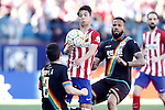 Atletico de Madrid's Oliver Torres (c) and Rayo Vallecano's  Tito Roman (l) and Bebe during La Liga match. April 30,2016. (ALTERPHOTOS/Acero)