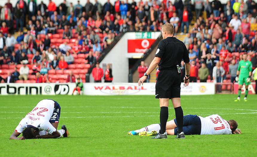 Referee Trevor Kettle stops play with both Bolton Wanderers' Sammy Ameobi and David Wheater down injured<br /> <br /> Photographer Kevin Barnes/CameraSport<br /> <br /> The EFL Sky Bet League One - Walsall v Bolton Wanderers - Saturday 17th September 2016 - Banks's Stadium - Walsall<br /> <br /> World Copyright &copy; 2016 CameraSport. All rights reserved. 43 Linden Ave. Countesthorpe. Leicester. England. LE8 5PG - Tel: +44 (0) 116 277 4147 - admin@camerasport.com - www.camerasport.com