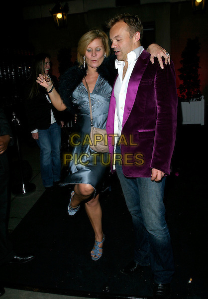 "GRAHAM NORTON & GUEST.Leaving the After Show Party for ""Dirty Dancing: The Classic Story On Stage"", Banquetting House, London, England, October 24th 2006..full length purple jacket jeans funny leg up dancing.Ref: AH.www.capitalpictures.com.sales@capitalpictures.com.©Adam Houghton/Capital Pictures."
