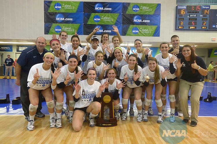 08 DEC 2012:  Players from Concordia University-St. Paul pose for a team photo after winning the final game against the University of Tampa during the Division II Women's Volleyball Championship held at the West Florida Field House in Pensacola, FL. Concordia defeated Tampa 3-2 to become national champions. Peter Lockley/NCAA Photos