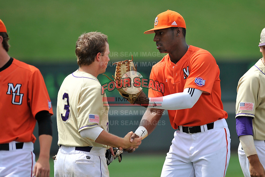 Center fielder Kyle Lewis (20) of the Mercer Bears shakes hands with J.D Long (3) after winning a SoCon Tournament game against Western Carolina on Saturday, May 28, 2016, at Fluor Field at the West End in Greenville, South Carolina. Mercer won, 9-8. (Tom Priddy/Four Seam Images)