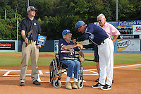 Asheville Tourists owner Brian DeWine displays plaques to former Tourists manager Ray Hathaway during Ray Hathaway night along with former major league manager Dave Bristol and current Tourists manager Joe Mikulik before a game against the Rome Braves at McCormick Field on August 20, 2011 in Asheville, North Carolina. Rome won the game 10-9.   (Tony Farlow/Four Seam Images)