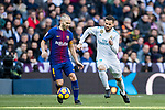 Andres Iniesta Lujan (L) of FC Barcelona battles for the ball with Nacho Fernandez of Real Madrid during the La Liga 2017-18 match between Real Madrid and FC Barcelona at Santiago Bernabeu Stadium on December 23 2017 in Madrid, Spain. Photo by Diego Gonzalez / Power Sport Images