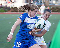 In a National Women's Soccer League Elite (NWSL) match, the Boston Breakers defeated the Western New York Flash  2-1, at Dilboy Stadium on May 5, 2013.  Boston Breakers forward Katie Schoepfer (12) and Western New York Flash defender Katherine Reynolds (16) compete for the ball near the Flash goal.