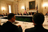 United States President Barack Obama meets with Business CEOs in the State Dining Room of the White House on January 31,2014.<br /> Credit: Dennis Brack / Pool via CNP