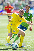 Columbus Crew defender Rich Balchan (2) takes the ball from Seattle Sounders FC midfielder Lamar Neagle (27) at CenturyLink Field in Seattle, Washington.