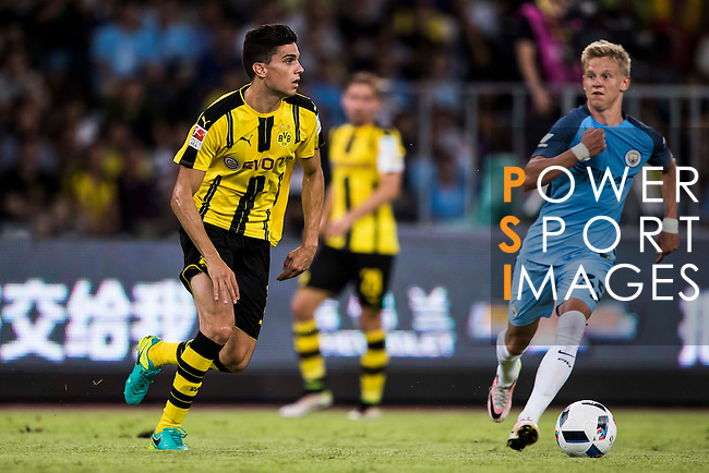 Borussia Dortmund defender Marc Bartra (l) during the match against Manchester City FC at the 2016 International Champions Cup China match at the Shenzhen Stadium on 28 July 2016 in Shenzhen, China. Photo by Victor Fraile / Power Sport Images