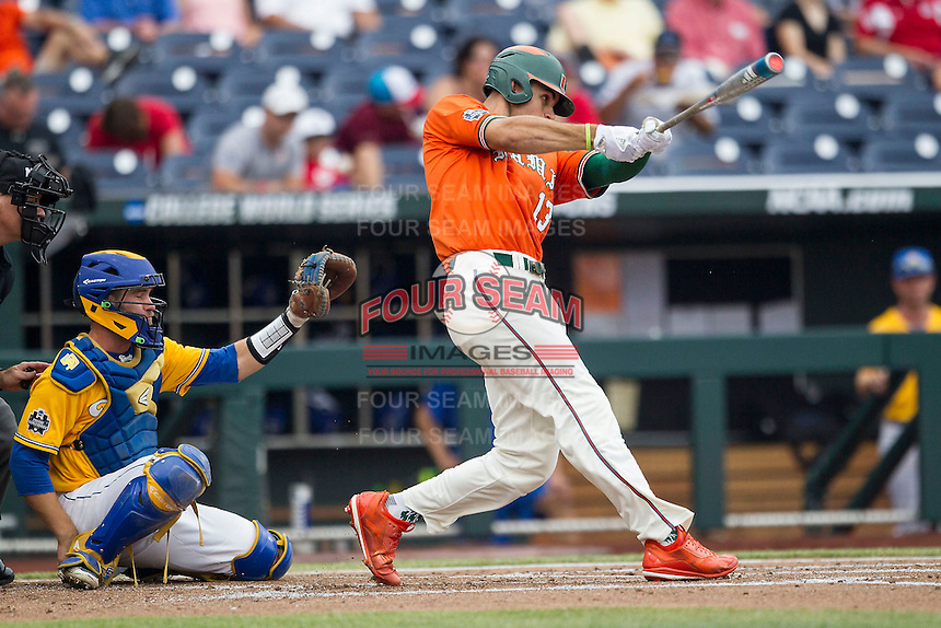 Miami Hurricanes outfielder Willie Abreu (13) swings the bat against the UC Santa Barbara Gauchos in Game 5 of the NCAA College World Series on June 20, 2016 at TD Ameritrade Park in Omaha, Nebraska. UC Santa Barbara defeated Miami  5-3. (Andrew Woolley/Four Seam Images)