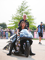 May 31, 2019; Joliet, IL, USA; Crew members with NHRA pro stock motorcycle rider Jianna Salinas during qualifying for the Route 66 Nationals at Route 66 Raceway. Mandatory Credit: Mark J. Rebilas-USA TODAY Sports