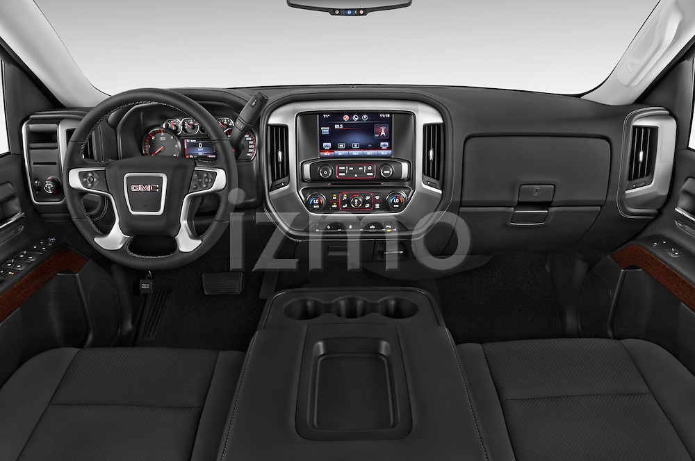 Stock photo of straight dashboard view of a 2015 GMC Sierra 1500 SLE 4 Door Pick-up Dashboard