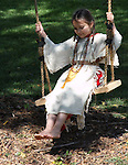 A young Native American Indian girl on a swing