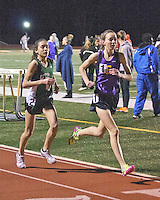 Eureka's Hannah Long-right, and Ste. Genevieve's Taylor Werner race under the lights at the Festus Tiger Town Track and Field Invitational, Tuesday, April 2, 2013, Festus, Mo. The pair who finished 10th-Long, and 13th-Werner at the 2012 FootLocker Cross Country Championships in December in San Diego, posted two of the top 10 times in the 3200 meters among high school girls at Festus, with Werner beating Long to the finish, 10:25.88 to 10:27.49.