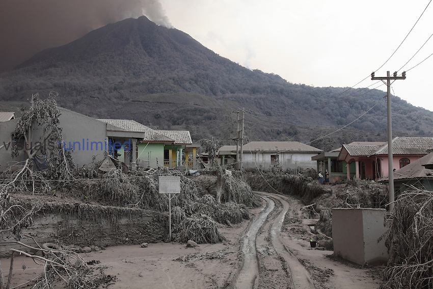 Village at foot of Sinabung Volcano coated in volcanic ash, Sumatra, Indonesia.
