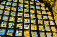 Fine Art Landscape Photograph. <br /> Stained glass window pane in The Hagia Sophia Mosque in Istanbul, Turkey. <br /> Individual patterns are created on each pain of glass by the warm golden rays of sunlight shining through the glass. <br /> All of the small panes of glass combine together with the  window trim to create a larger pattern that emanates a golden glow into the Topkapi Palace.