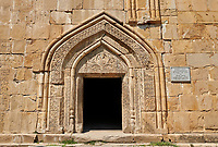 Pictures &amp; images of the Church of the Assumption exterior bas relief Georgian stone work around the doorway,1689, Ananuri castle complex &amp; Georgian Orthodox churches, 17th century, Georgia (country).<br /> <br /> Ananuri castle is situated next to the Military Road overlooking the Aragvi River in Georgia, about 45 miles (72 kilometres) from Tbilisi. It was the castle of the eristavis (Dukes) of Aragvi from the 13th century and was the scene of numerous battles. In 2007 Ananuri castle was enscribed on the   UNESCO World Heritage Site tentative list.