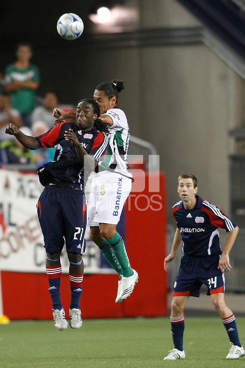 New England Revolution midfielder Shalrie Joseph (21) and Santos Laguna midfielder Johnny Garcia (8) go up for a header. The New England Revolution defeated Santos Laguna 1-0 during a Group B match of the 2008 North American SuperLiga at Gillette Stadium in Foxborough, Massachusetts, on July 13, 2008.