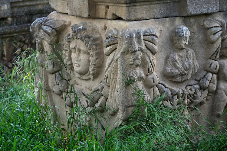 Various figures adorn the foot of this column in the Aphrodisias archeology site in Turkey.