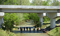 NWA Democrat-Gazette/BEN GOFF @NWABENGOFF<br /> A search team walks through Glade Creek Monday, May 1, 2017, under U.S. Routh 412 in Madison County near Hindsville. Multiple agencies and volunteers are continuing to search the area where a 4-year-old boy and 18-month-old girl were lost when their mother's vehicle was swept off a low-water bridge Saturday.