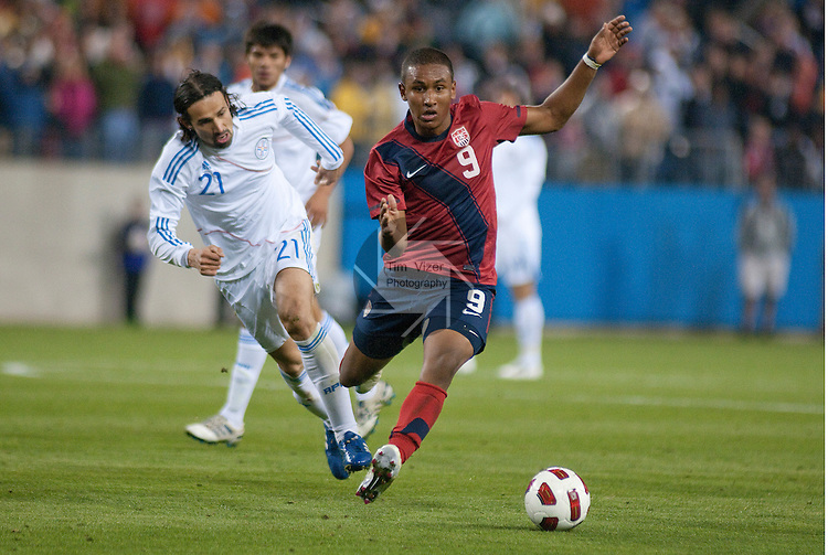 March 29,  2011     USA forward Juan Agudelo (9, right) runs with the ball in the second half as he's pursued by Paraguay defender Victor Hugo Mareco (21).  Paraguay defeated the USA Men's National Soccer Team 1-0 in an international friendly game on Tuesday March 29, 2011 at LP Field in Nashville, Tennessee.