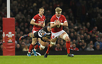 Wales Aaron Wainwright evades the tackle from Barbarians Luke Jones<br /> <br /> Photographer Ian Cook/CameraSport<br /> <br /> 2019 Autumn Internationals - Wales v Barbarians - Saturday 30th November 2019 - Principality Stadium - Cardifff<br /> <br /> World Copyright © 2019 CameraSport. All rights reserved. 43 Linden Ave. Countesthorpe. Leicester. England. LE8 5PG - Tel: +44 (0) 116 277 4147 - admin@camerasport.com - www.camerasport.com