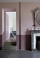 The unusual paint colours in some of the rooms, such as this dusty pink and violet found in an upstairs hall, were mixed by local artisan Yann Rossignol
