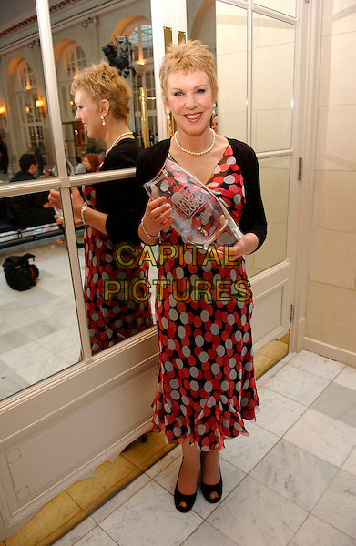 BARBARA CLARKE.received a special recognition award.Tesco Magazine Mum Of The Year Awards.Waldorf Hotel, London, England .15 Jauary 200.Ref: FIN.full length trophy red polka dot dress peep toe.www.capitalpictures.com.sales@capitalpictures.com.©Steve Finn/Capital Pictures